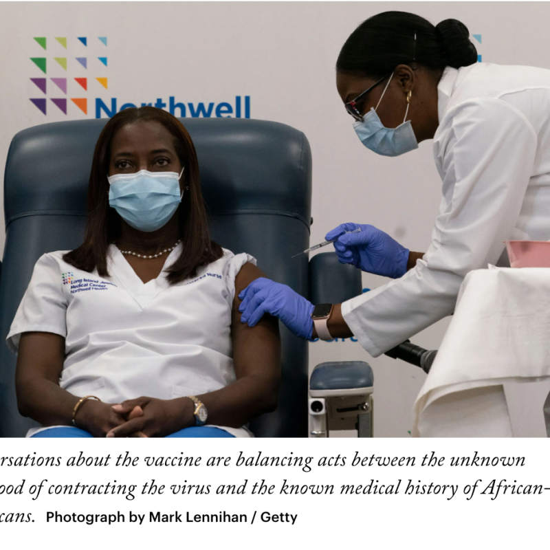In this picture, there are two Black, Indigenous and People of Colour, read as women. One is injecting the vaccine, while the other is receiving the vacine. Health and safety measures are being respected, such as wearing medical gloves. Also, this picture clearly reminds us, that we are still in a worldwide pandemic, since both people are wearing a mask. The person receiving the vaccine has one hand in the other, while the other person is cautiously injecting the vaccine.
